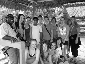 Students take a break for a photo with their guide in Peru.