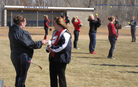 Dual coaching capabilities: Jen Close takes reins in basketball and softball
