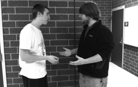 Senior Adam Everhart and sophomore Joe Blom debate about  national competition in June.