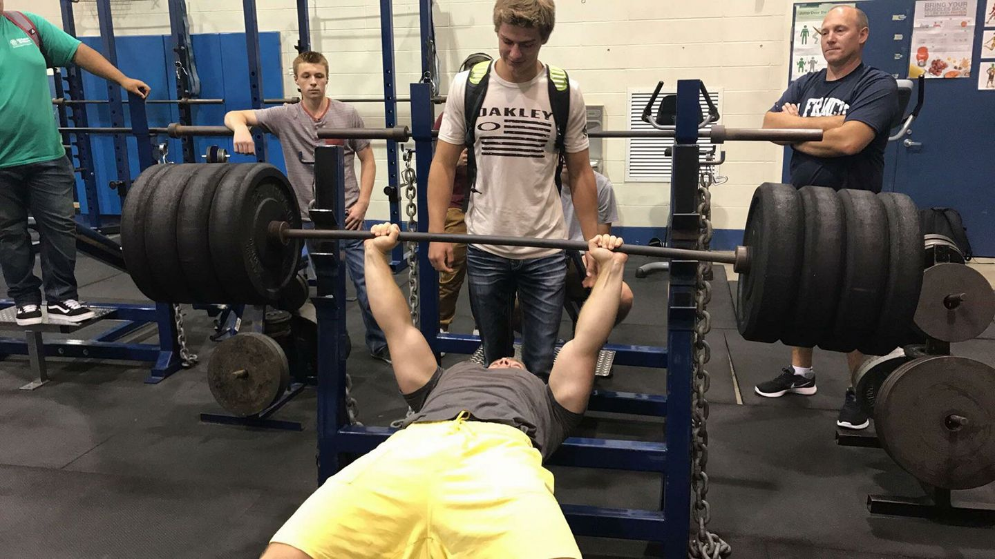 Senior Aaron Moskness  breaks the school bench record on September 12 during Saints Time, with a lift of 370 pounds.