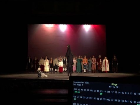 A view of the stage from the tech booth as students perform A Christmas Carol for a benefit performance for SFHS Theatre.