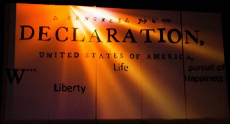 The backdrop of the One Act Competition Play - Declaration by Jonathon Dorf.